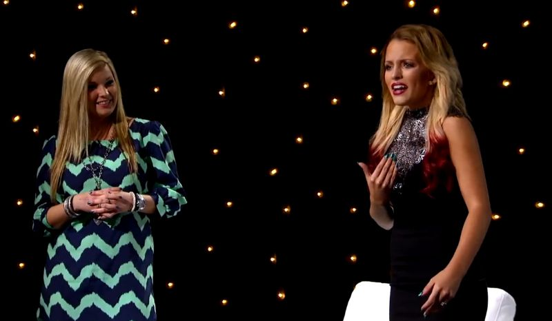 Maddie Walker sings while Rachel Hallack watches